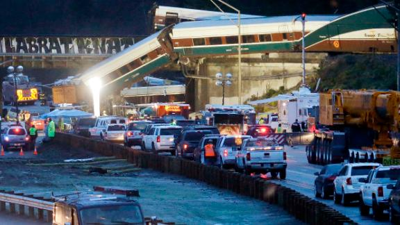 Emergency workers respond to the derailment shortly after it happened on Monday, December 18.