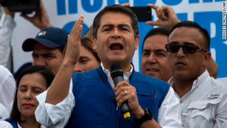 Honduran President Juan Orlando Hernandez speaks to his party base, in Tegucigalpa, Honduras, Thursday, Dec. 7, 2017. Eight Latin American governments on Wednesday applauded Honduras' willingness to recount disputed votes in the presidential elections, but questions remain about how thorough that recount will be. (AP Photo/Moises Castillo)