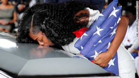 FILE PHOTO: Myeshia Johnson, wife of U.S. Army Sergeant La David Johnson, who was among four special forces soldiers killed in Niger, kisses his coffin at a graveside service in Hollywood, Florida, October 21, 2017.  REUTERS/Joe Skipper/File Photo (Newscom TagID: rtrlnine240461.jpg) [Photo via Newscom]