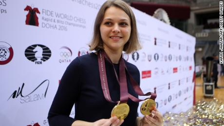 Ukraine's grandmaster Anna Muzychuk celebrates after winning two gold medals in the FIDE  World Chess Rapid & Blitz Championships 2016, in the Qatari capital Doha on December 30, 2016.