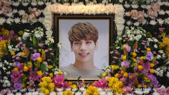 "The portrait of Kim Jong-Hyun, a 27-year-old lead singer of the massively popular K-pop boyband SHINee, is seen on a mourning altar at a hospital in Seoul on December 19, 2017. The top K-pop star bemoaned feeling ""broken from inside"" and ""engulfed"" by depression in a suicide note, it emerged on December 19, as his death sent shockwaves across K-pop fans worldwide.  / AFP PHOTO / pool / CHOI Hyuk        (Photo credit should read CHOI HYUK/AFP/Getty Images)"