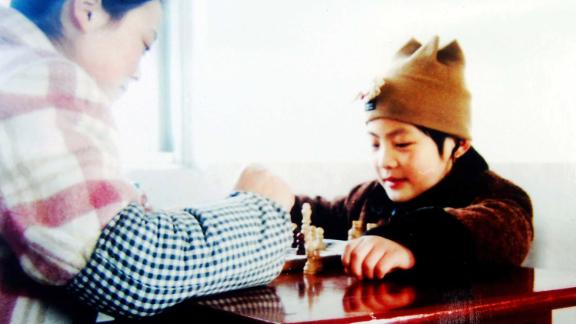 Hou (pictured) first learnt chess at the age of five.