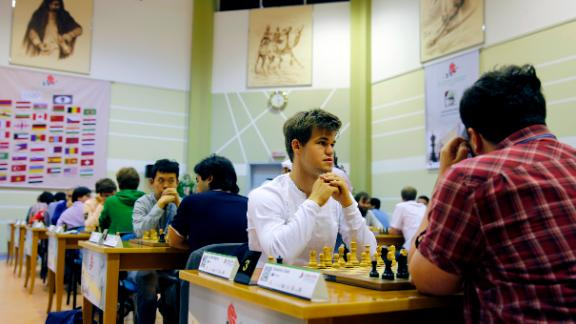 In 2014, Carlsen (pictured here at the World Rapid and Blitz Championships in Dubai 2014) became the first player to hold the World Champion title in Standard, Rapid and Blitz chess.  <br />