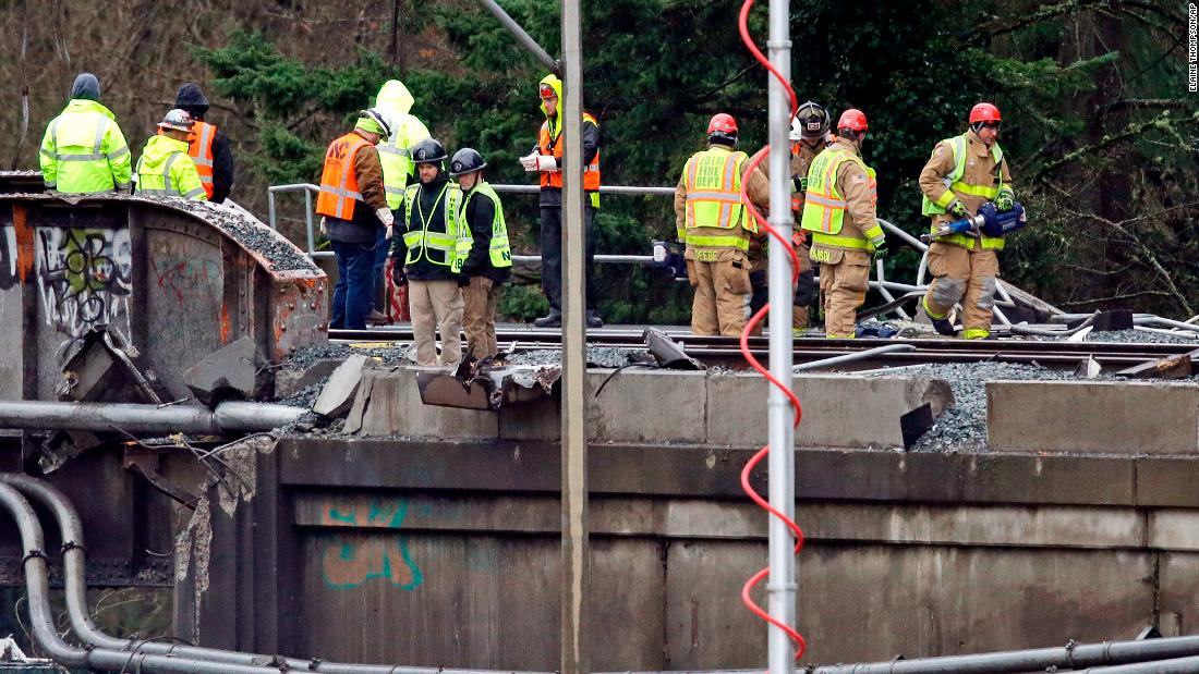 Men work at the scene of the derailment on December 19.