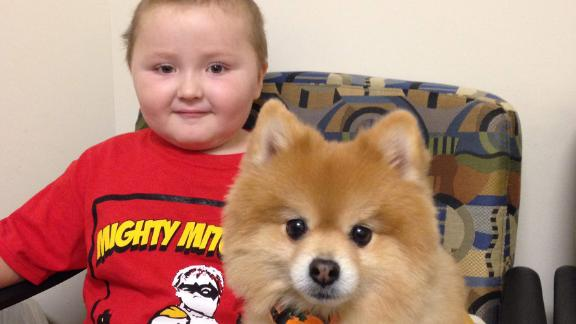 """Four-year-old """"Mighty"""" Mitchell Montalbano with Swoosh during the 2014 clinical trial."""