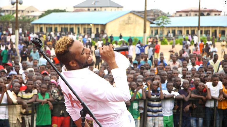 Nigerian singer Lamboginny performs in front of prisoners at Kirikiri Prison, Lagos