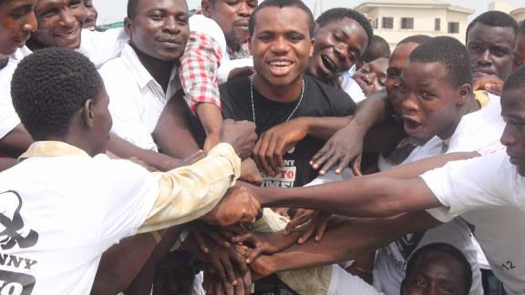 Lamboginny with some prisoners he helped to get released after a prison concert in Ikoyi Prison, Lagos in 2012.
