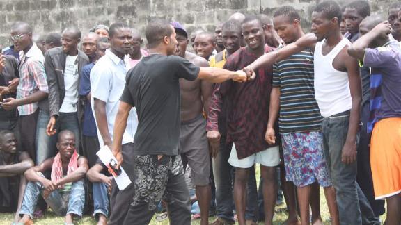 Lamboginny greeting prison inmates at Ikoyi Prison, Lagos just before his performance.