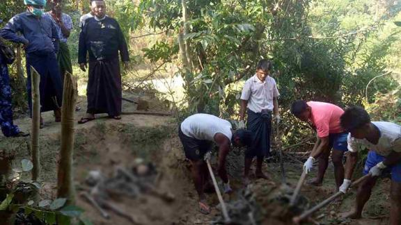Authorities in Rakhine state work to uncover a mass grave found in a village north of the provincial capital Sittwe.