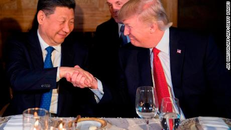 US President Donald Trump and Chinese President Xi Jinping shake hands during dinner at the Mar-a-Lago estate in West Palm Beach, Florida, on April 6, 2017.