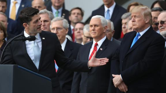 WASHINGTON, DC - DECEMBER 20:  U.S. House Speaker Paul Ryan (R-WI) gestures to President Donald Trump, flanked by Republican lawmakers, at a celebration of Congress passing the Tax Cuts and Jobs Act on the South Lawn of the White House on December 20, 2017 in Washington, DC. The tax bill is the first major legislative victory for the GOP-controlled Congress and Trump since he took office almost one year ago.  (Photo by Chip Somodevilla/Getty Images)