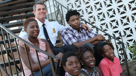 Ebony Rhodes, left, and her four children were living in her car until Atlanta Deputy Police Chief Jeff Glazier came to the rescue.