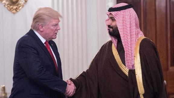US President Donald Trump and Saudi Deputy Crown Prince and Defense Minister Mohammed bin Salman shake hands in the State Dining Room before lunch at the White House in Washington, DC, on March 14, 2017.Trump welcomed the prince to the Oval Office, as both countries expect to improve ties that were frequently strained under Barack Obama