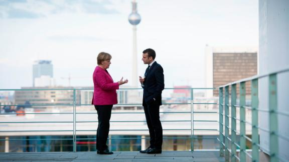 BERLIN, GERMANY - MAY 15:  In this handout photo provided by the German Government Press Office (BPA), German Chancellor Angela Merkel talks with newly-elected French President Emmanuel Macron on the terrace, with a view of the television tower in the background during his visit to the chancellor