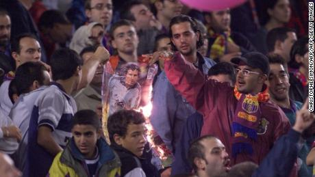 Barca players burn a picture of Luis Figo after he controversially moved to Real for a then world-record fee in 2000