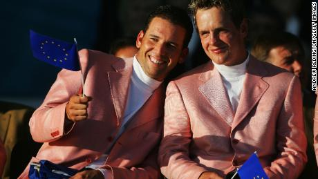 Sergio Garcia (L) and Luke Donald wave European flags at 2006 closing ceremony