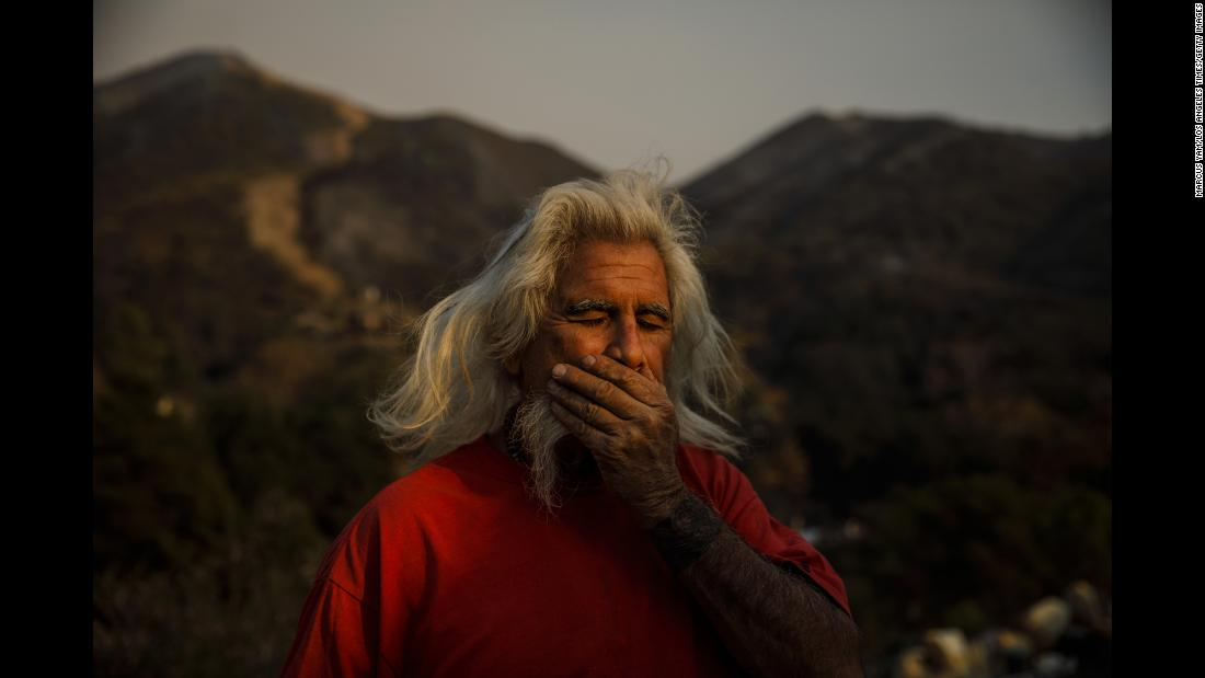"Rusty Smith stands outside his home in Flores Flats, near Montecito, California, on Sunday, December 17. A spate of California wildfires has destroyed an area larger than New York City and Boston -- combined. And with about 60% of the colossal Thomas Fire contained, the end may be a long way off. <a href=""http://www.cnn.com/2017/12/11/us/california-wildfires-numbers/index.html"" target=""_blank"">The California wildfires by the numbers</a>"