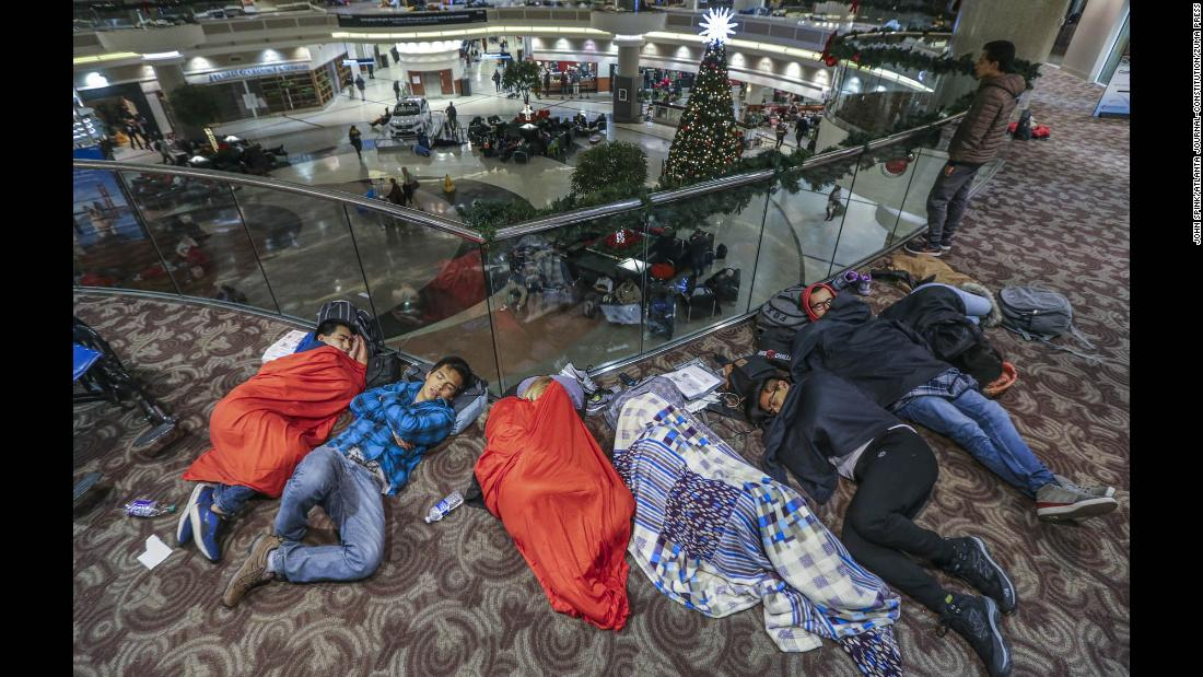 "Travelers sleep at Hartsfield-Jackson International Airport in Atlanta on Monday, December 18, the day after a <a href=""http://www.cnn.com/2017/12/18/us/atlanta-airport-power-outage/index.html"" target=""_blank"">massive power outage</a> brought operations to a halt. The outage, which affected all airport operations, started with a fire in a Georgia Power underground electrical facility, Mayor Kasim Reed said. An estimated 30,000 people were affected."