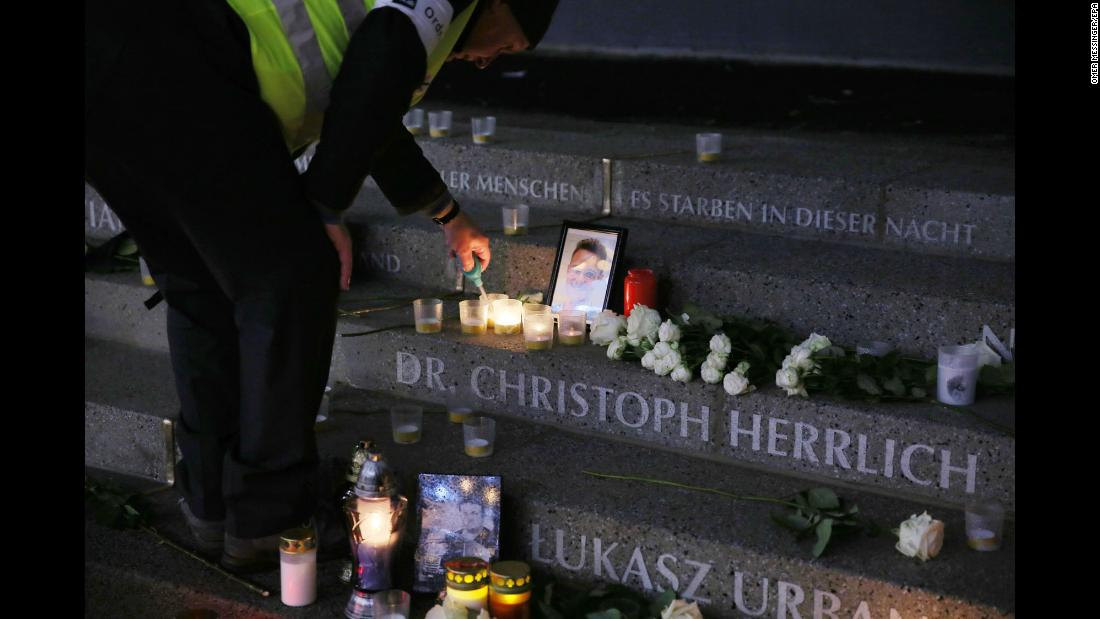 "A person lights a candle at a memorial in Berlin, marking the first anniversary of a terrorist attack at a Christmas market on Tuesday, December 19. Twelve people were killed in <a href=""http://www.cnn.com/2016/12/23/europe/berlin-christmas-market-attack-suspect-killed-milan/index.html"" target=""_blank"">December 2016</a> and at least 48 were wounded when a man driving a tractor-trailer rammed into a crowd at a Christmas market filled with holiday shoppers in Berlin."