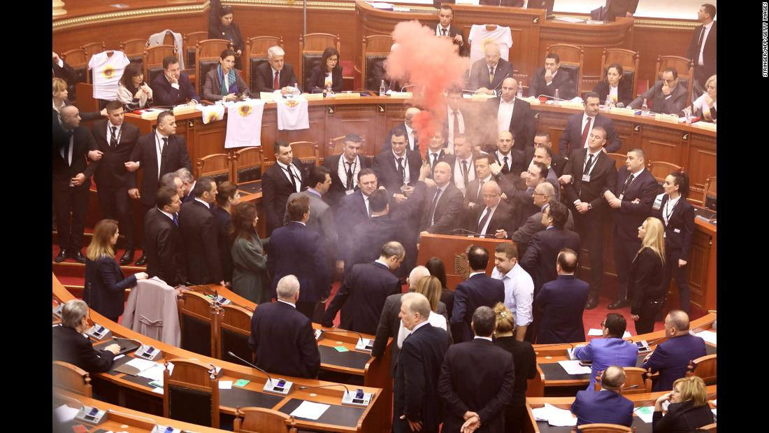 Opposition lawmakers set off smoke bombs in Parliament during a vote for the new temporary general prosecutor in Tirana, Albania, on Monday, December 18.