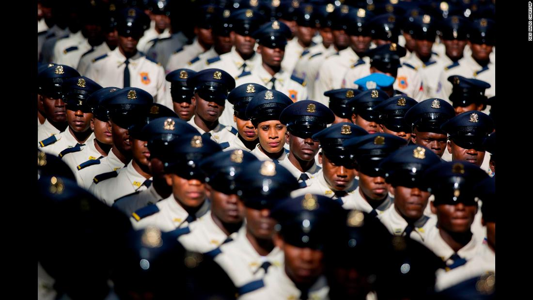 New members of the National Police parade during their graduation ceremony from the Police Academy in Port-au-Prince, Haiti, on Monday, December 18.