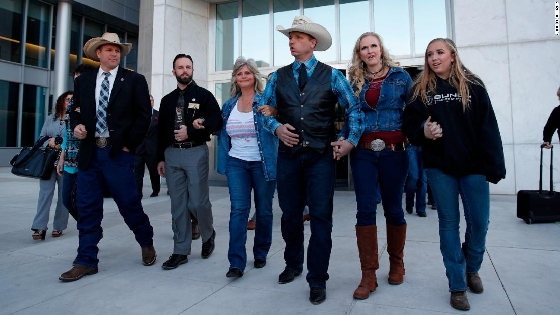 "A group walks out of a federal courthouse in Las Vegas on Wednesday, December 20. From left are Ammon Bundy, Ryan Payne, Jeanette Finicum, Ryan Bundy, Angela Bundy, and Jamie Bundy. Chief US District Judge Gloria Navarro declared a mistrial Wednesday in the case against Cliven Bundy, his sons Ryan and Ammon, and Payne. In <a href=""http://www.cnn.com/2016/02/16/us/cliven-bundy-bail-hearing-oregon/index.html"" target=""_blank"">February 2016</a>, embattled rancher Cliven Bundy and four others -- including his sons, who led the takeover of the Malheur National Wildlife Refuge in Oregon -- were indicted by a federal grand jury on charges stemming from a 2014 armed standoff."