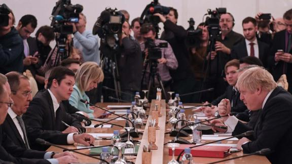 Russian Foreign Minister Sergei Lavrov, second left, and UK Foreign Secretary Boris Johnson, right, take part in talks Friday in Moscow.