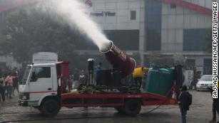 Delhi tests water cannons to combat deadly air pollution