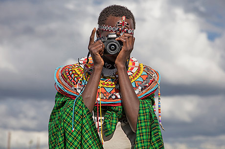Anita, 15, takes a photo during the Tehani Photo Workshop, which was held earlier this year for 18 Kenyan girls who escaped child marriage. (Stephanie Sinclair/Too Young to Wed)