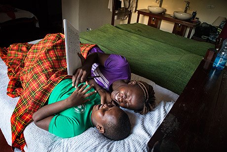 "Linnet, left, and Eunice — both 15 — share a laugh in their rooms at the Ngari Hill Eco-Lodge in Maralal, Kenya. ""What I tried to show while taking that photo is that the girls are happy because they are studying,"" said Mary, a 16-year-old who took the photo. (Courtesy Mary/Too Young To Wed)"
