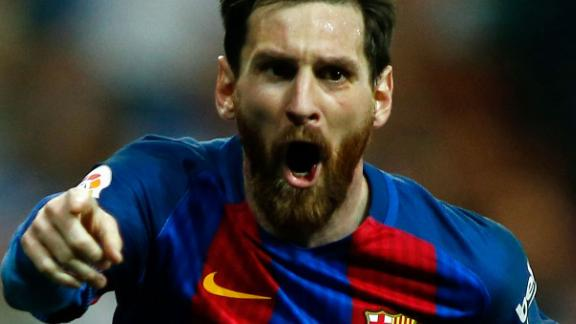 Barcelona's Argentinian forward Lionel Messi celebrates after scoring during the Spanish league Clasico football match Real Madrid CF vs FC Barcelona at the Santiago Bernabeu stadium in Madrid on April 23, 2017. / AFP PHOTO / OSCAR DEL POZO        (Photo credit should read OSCAR DEL POZO/AFP/Getty Images)