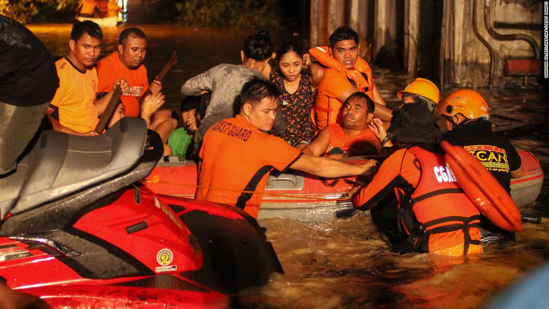 Evacuations are underway in flood-affected areas of Davao on December 23. At least 30,000 people have gone to shelters on the island of Mindanao, an official says.