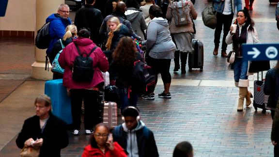 Holiday travelers line up Friday to catch a train to Boston from Union Station in Washington.