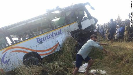 The pilgrims' bus is pulled from the Banas River after the fatal accident in Sawai Madhopur, India, on Saturday.