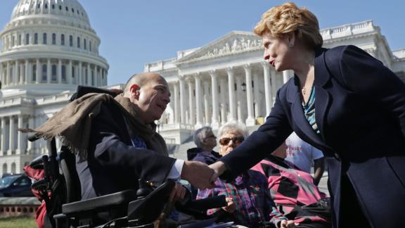WASHINGTON, DC - MARCH 09:  Sen. Debbie Stabenow (D-MI) (R) thanks Kent Keyser following a news conference with people who may be negatively affected by the proposed American Health Care Act, the Republicans