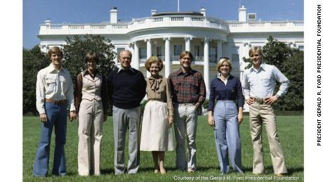 The Ford family poses on the South Lawn, with the Jackson Magnolia visible on the left.