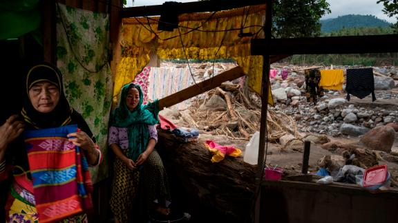 Residents huddle in their devastated house on December 25 in Salvador, Lanao del Norte province.