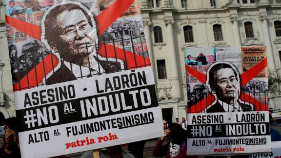 """Demonstrators protest against pardon of former President Alberto Fujimori in Lima, Peru, Monday, Dec. 25, 2017. Peru's President Pedro Pablo Kuczynski announced Sunday night that he granted a medical pardon to the jailed former strongman who was serving a 25-year sentence for human rights abuses, corruption and the sanctioning of death squads. The poster reads in spanih: """"Assassin, Thief, Not to pardon"""".(AP Photo/Martin Mejia)"""