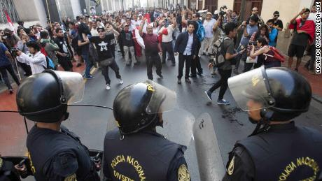 Police and protesters face off during a rally against the pardoning of Alberto Fujimori on Monday.