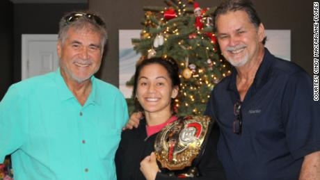 Robinson, left, with MMA Flyweight World Champion Ilima-Lei Macfarlane and his brother.