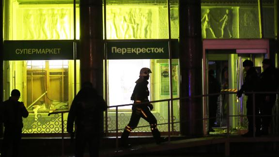 Firefighters respond to the blast at the Perekrestok supermarket in Kalinina Square.