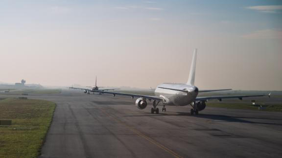 Commercial airplane queue and taxiing on tarmac to take off on runway on a morning ; Shutterstock ID 577160230; Job: -