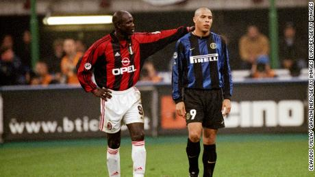 Weah in the red and black of AC Milan consoles Ronaldo of Inter Milan after his sending off during a Serie A match at the San Siro in Milan, Italy.