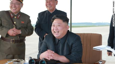 "This undated picture released from North Korea's official Korean Central News Agency (KCNA) on September 16, 2017 shows North Korean leader Kim Jong-Un (R) inspecting a launching drill of the medium-and-long range strategic ballistic rocket Hwasong-12 at an undisclosed location. Kim vowed to complete North Korea's nuclear force despite sanctions, saying the final goal of his country's weapons development is ""equilibrium of real force"" with the United States, state media reported on September 16.  NK leadership watch says:  Kim Jong Un watches a missile drill on September 15, 2017. Also in attendance behind him are Kim Jong Sik and Ri Pyong Chol (Photo: KCNA)."