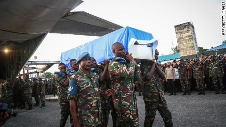 Tanzanian soldiers carry the coffin of a UN peacekeeper in the Tanzanian capital of Dar es Salaam on December 11.