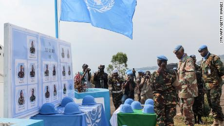 Helmets of Tanzanian peacekeepers slain by rebels are displayed during a tribute ceremony in the Congolese city of Goma.