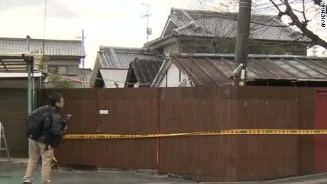 Crime scene tape rings the Osaka, Japan, home where a couple allegedly imprisoned their daughter.