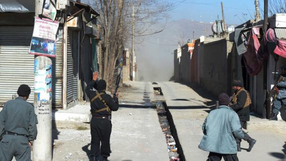 Afghan policemen in Kabul after the attack on Thursday.