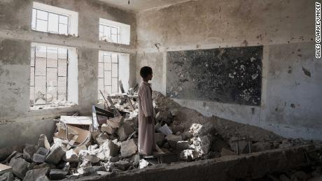 A student stands in the ruins of one of his bombed-out classrooms in Saada, Yemen, on April 24.
