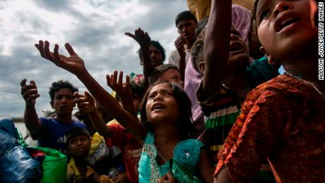 Rohingya children beg for food after arriving on a boat from Myanmar to Shah Porir Dip, Bangladesh, on September 14.